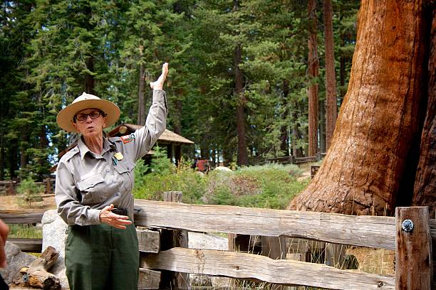 Park Ranger Talk at Sequoia NP Three Rivers, California – September 14, 2014: A park ranger gives a nature talk near the Giant Forest Museum at Sequoia National Park. park ranger stock pictures, royalty-free photos & images