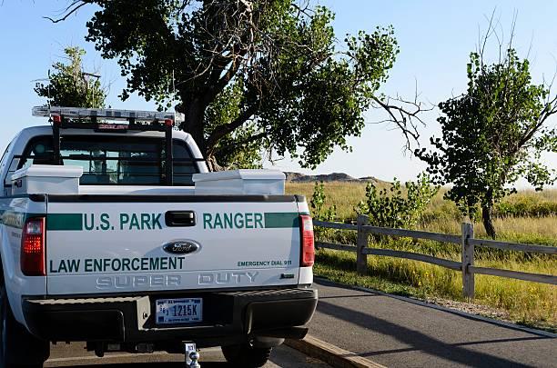 U.S. Park Ranger Truck Wall, South Dakota, USA - September 5, 2011: A U.S. Park Ranger truck parked in Badlands National Park outside of Wall, South Dakota. park ranger stock pictures, royalty-free photos & images