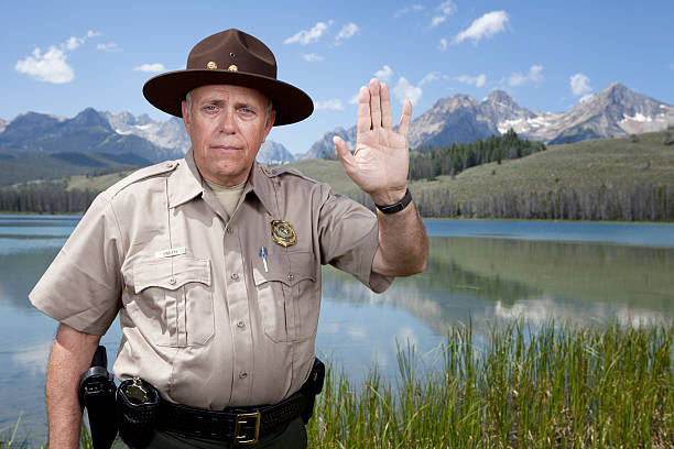 Park Ranger with Stop Gesture http://dieterspears.com/istock/links/button_military.jpg park ranger stock pictures, royalty-free photos & images