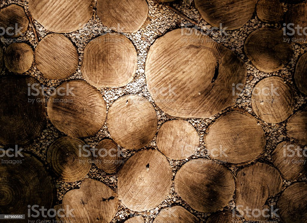 Park walkway made of natural round wooden logs stock photo