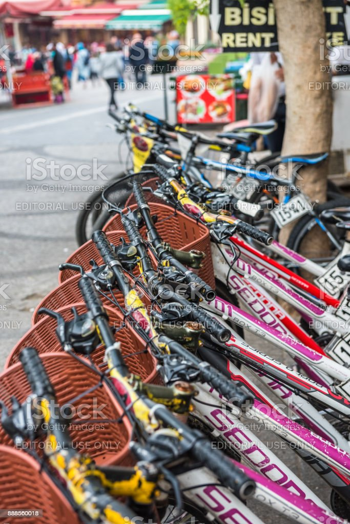 parked bicycles bikes for rent on sidewalk stock photo