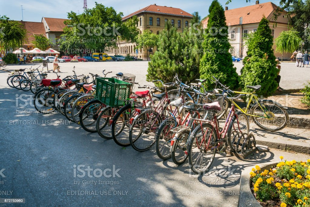 parked bicycles in the center of Sombor stock photo