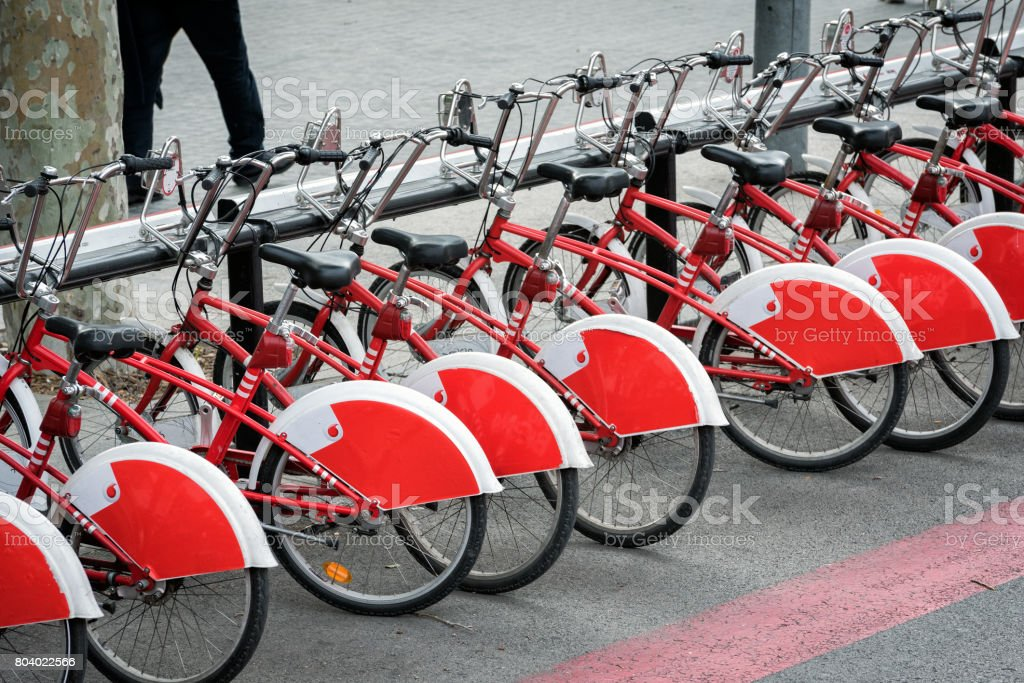 Parked bicycles on street of Barcelona town, Spain stock photo