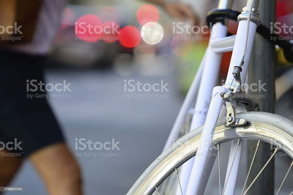 Parked bike on sidewalk in the city royalty-free stock photo
