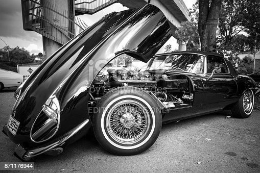 Hamburg, Germany - August 8. 2017: Parked black Jaguar with open Motorhood in Hamburg, Germany. Image was developed in black and white.