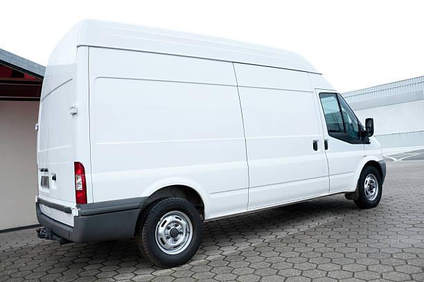geparkt leeren weißen van - motionless in white stock-fotos und bilder