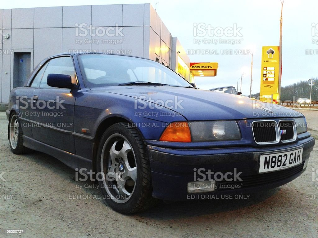Parked blue BMW M3 (E36) at gas station royalty-free stock photo