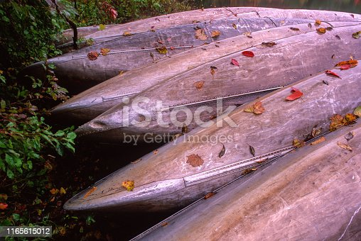 Canoes stacked together