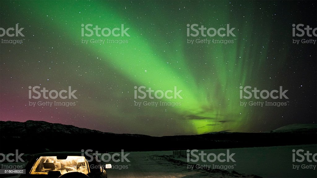 Parked Car And Northern Lights stock photo