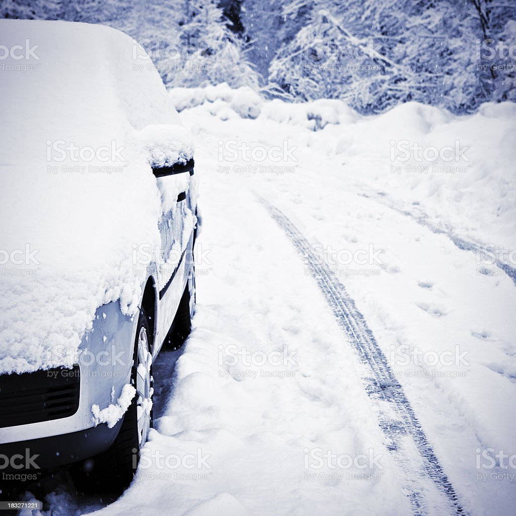 Parked car covered with snow royalty-free stock photo