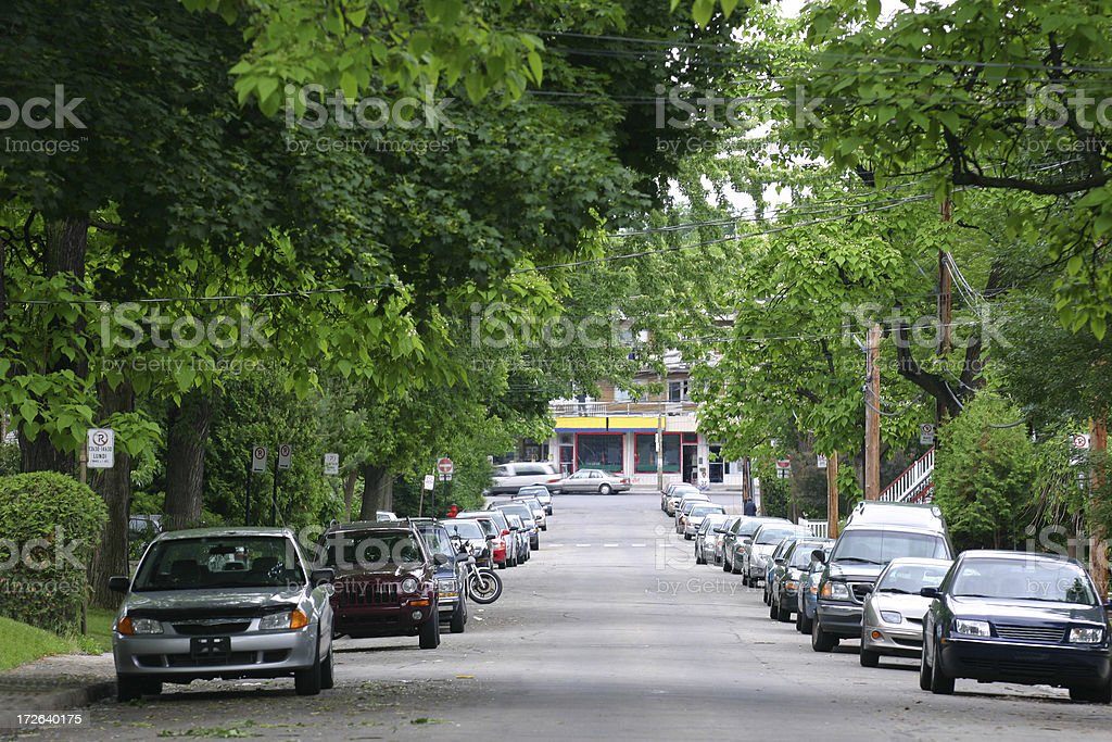 Parked cars in residential street stock photo