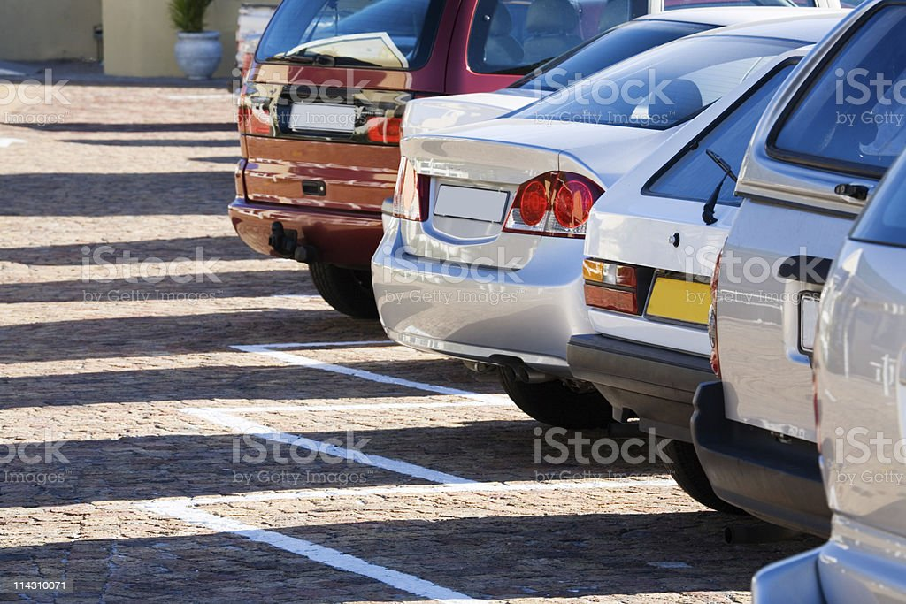 Parked cars, long shadows royalty-free stock photo