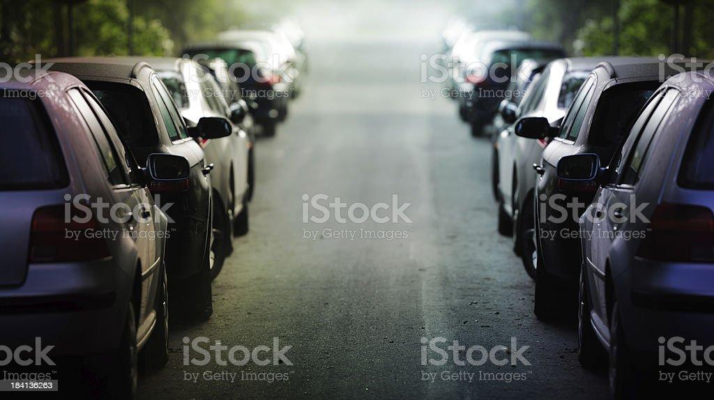 Parked cars on twilight street stock photo