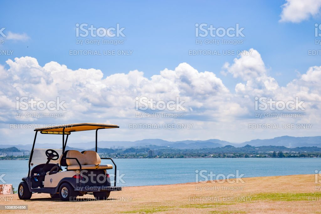 Parked Empty Golf Cart In San Juan Stock Photo - Download ... on bicycle in water, go kart in water, golf hole in water, backhoe in water, golf near water, golf hole on water, tools in water, scooter in water, electric vehicle in water, gps in water, trailer in water, generator in water, volkswagen in water, grill in water, camper in water, wheelchair in water, golf by water, bus in water, utv in water, plants that grow in water,