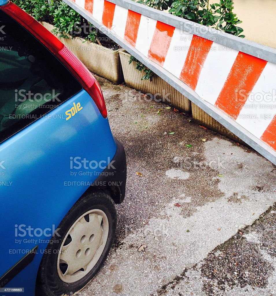 Parked Fiat Punto with the sun inside stock photo