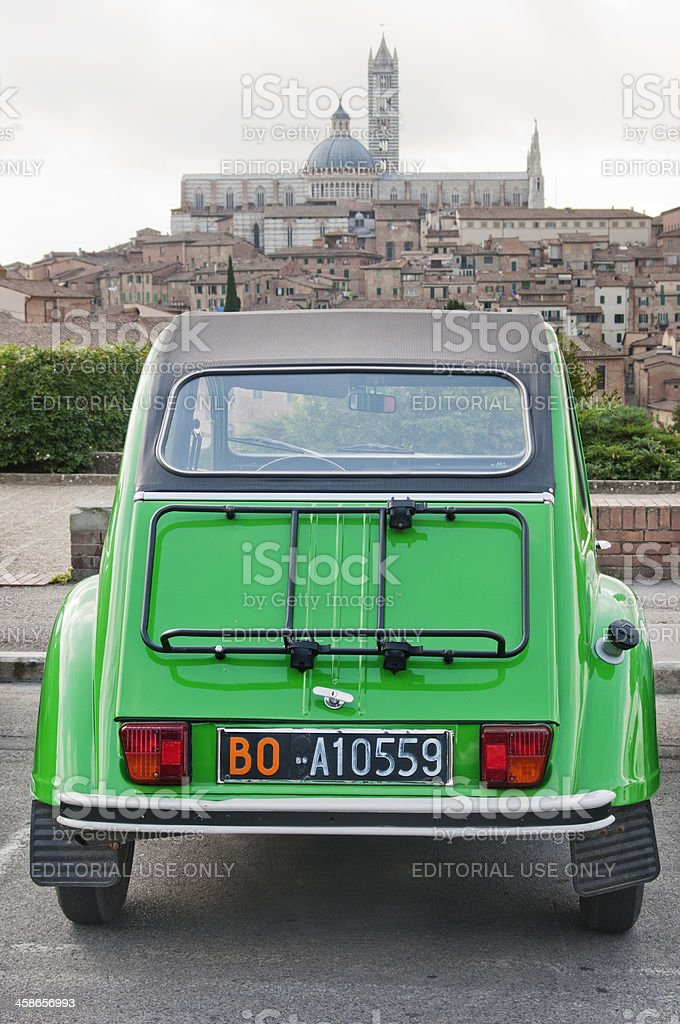 Parked green Citroen 2CV with view of Tuscany royalty-free stock photo