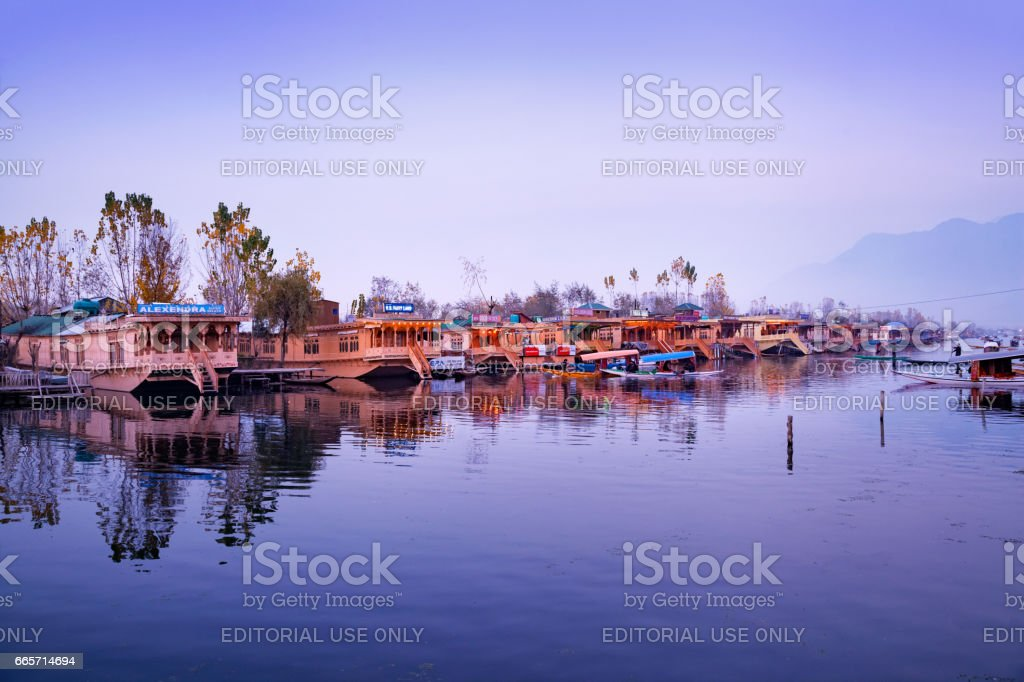 Parked houseboats on the bank of Dal Lake stock photo