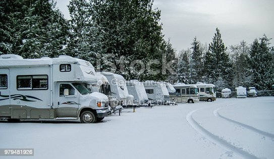 Port Townsend, Washington, USA. January 3, 2015 RV's parked in a snow covered storage area.