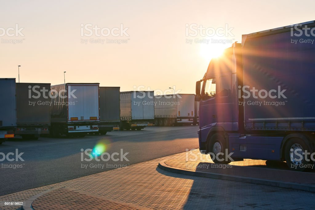 Parked loaded trucks waiting area on border crossing at the evening stock photo