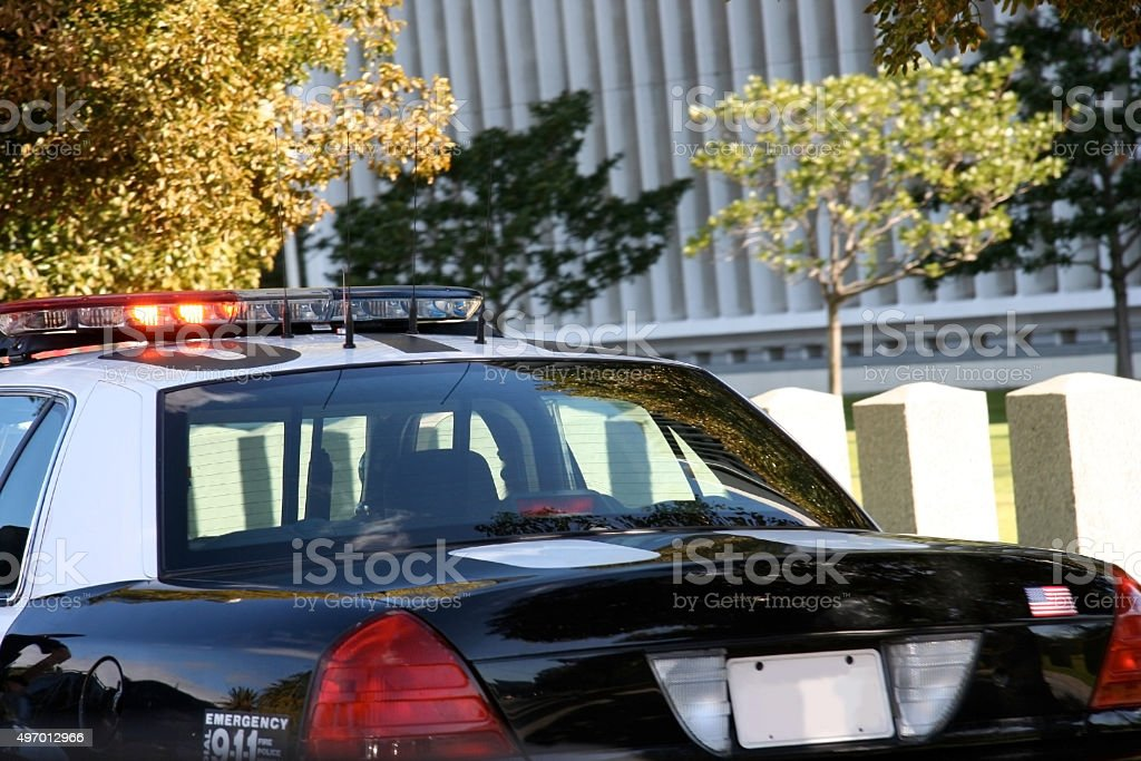 Parked Police Car with Flashing Lights stock photo
