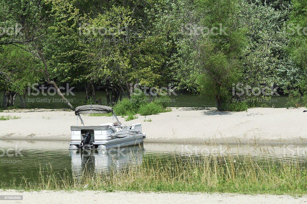 Parked Pontoon Boat royalty-free stock photo