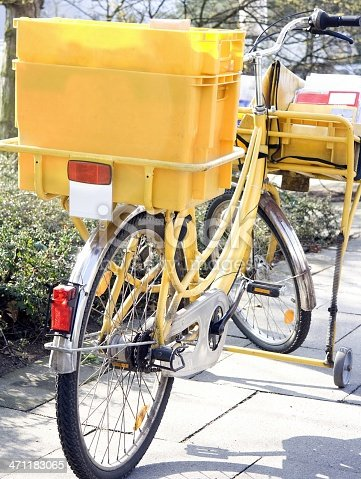 istock Parked post bicycle with open box outdoors 471183065