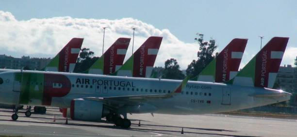 parked tap air portugal passengers airplane at lisbon airport due to covid-19 pandemic in portugal. europe - resultados lisboa imagens e fotografias de stock