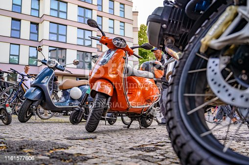 Berlin, Germany - June 28, 2019: Parked colorful two-wheeled vehicles on the edge of a street festival in Berlin, Germany.