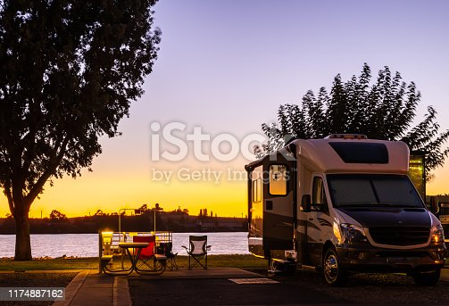 Rv parked at a campsite in the delta,  Rio Vista, Ca. under a beautiful sunset sky