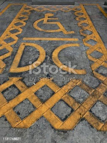 666724598istockphoto Parking area for handicap 1131748621