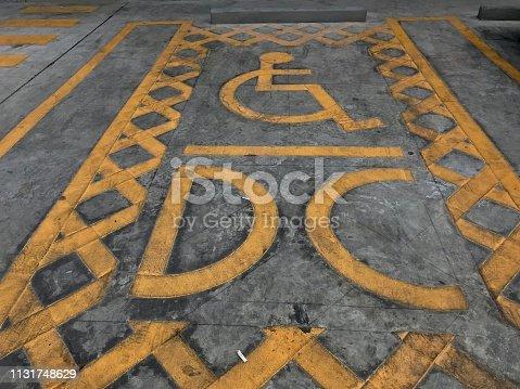666724598istockphoto Parking area for handicap 1131748629