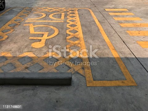 666724598istockphoto Parking area for handicap 1131748631