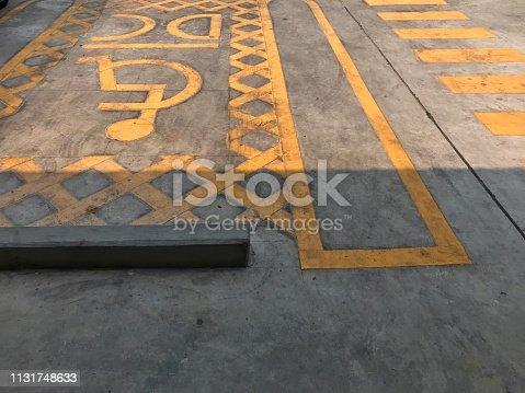 666724598istockphoto Parking area for handicap 1131748633