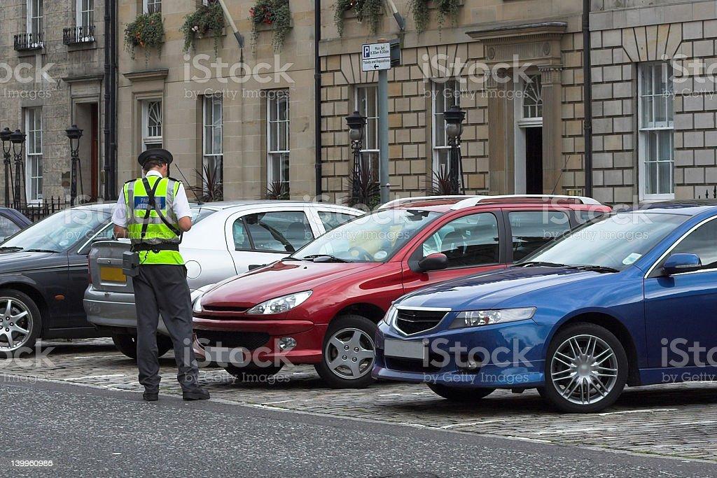 parking attendant, traffic warden, getting ticket fine mandate stock photo