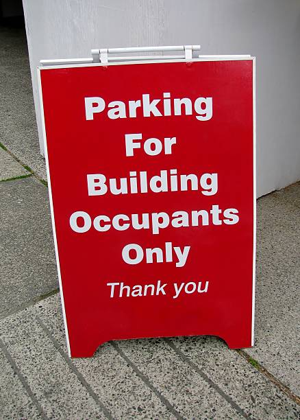 Parking  For Building Occupants Only sign. stock photo