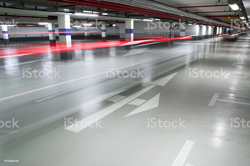 Parking garage, cars passing by - motion blur royalty-free stock photo