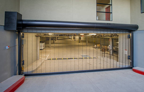 Parking Garage Entry Gate Security gate for parking garage, evening. security barrier stock pictures, royalty-free photos & images