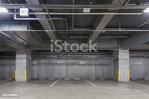 istock Parking garage underground interior 832099802