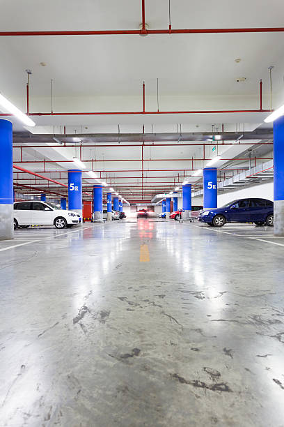 Parking garage, underground interior with a few parked cars stock photo