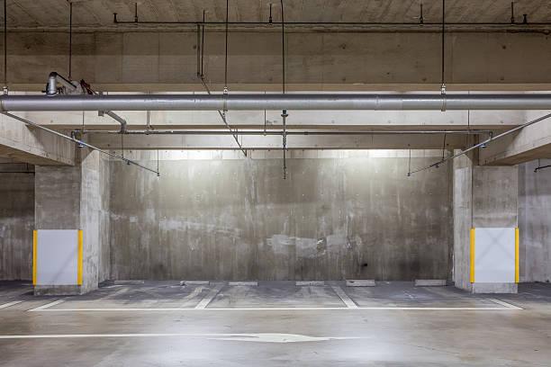 Parking garage underground interior with neon lights stock photo