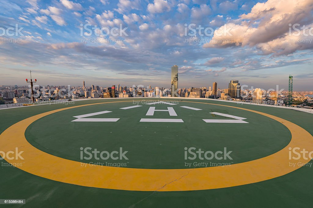 Parking helicopter on rooftop in the city stock photo