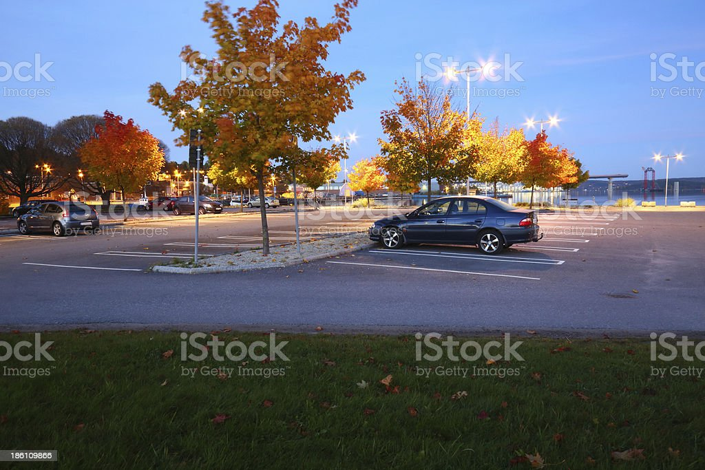 Parking lot an evening a few cars in the light royalty-free stock photo