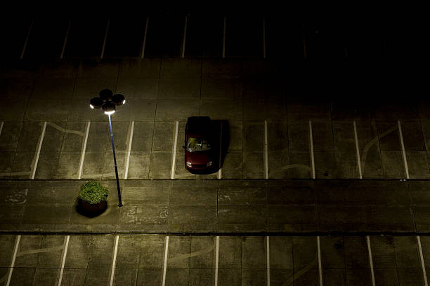 parking lot at night - stealing crime stock photos and pictures