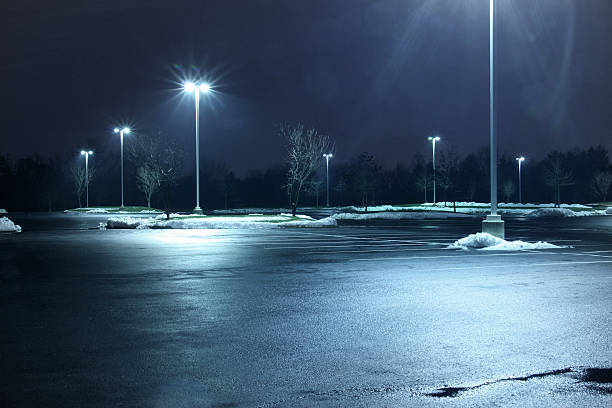 parking lot at night - wet stock pictures, royalty-free photos & images