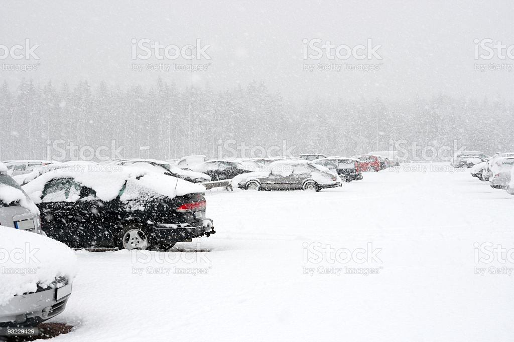 Parking lot full of cars covered in snow in winter stock photo