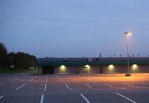 Parking Lot In Evening Empty German parking lot in the evening. medium shot stock pictures, royalty-free photos & images