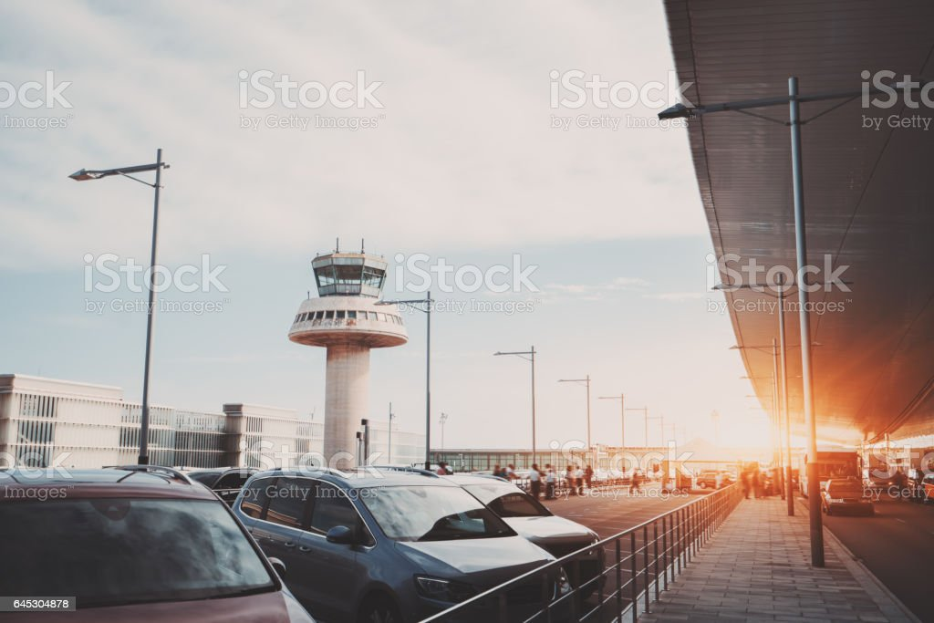 Parking lot of modern airport terminal stock photo