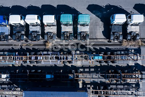 1142724396 istock photo Parking lot where transportation trucks are lined up 1095826642