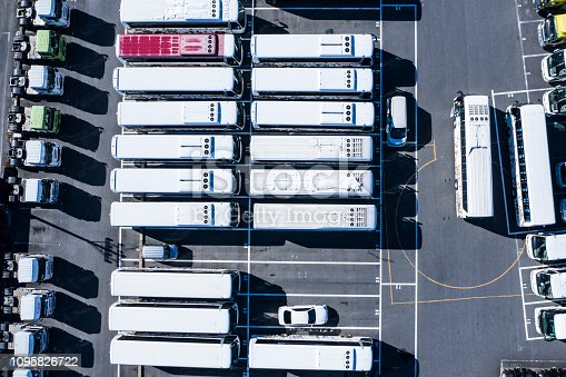 1142724396 istock photo Parking lot with large trucks and buses 1095826722
