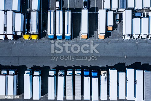 1142724396 istock photo Parking lot with large trucks and buses 1133710351